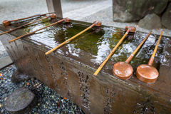 Water purification at the Buddhist temple Royalty Free Stock Image