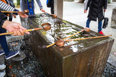 Water purification at the Buddhist temple. Water purification at entrance of the Japanese temple Royalty Free Stock Photography