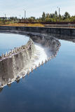 Water purification in sedimentation reservoirs. With overflowing sewage Royalty Free Stock Photo