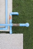 Water PVC Plastic Pipes. Blue PVC pipe and valve to Water pump Royalty Free Stock Photo