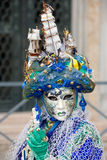 Water queen. A hat and costume with a nautical theme at the Venice carnival