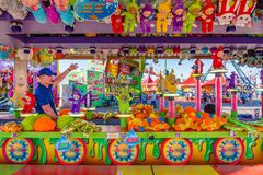 Water Race Game. Phoenix, Arizona - October 25, 2017: A carny tries to attract players to his water gun game at the Arizona State Fair in Phoenix Royalty Free Stock Image