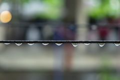 Water Rain Drops on the Metal Sling After Rain.  Royalty Free Stock Photography