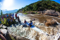 Water Rapids Canoe Race. Canoeing team in mission rapids in front of media corner at this favorite spectator site in the race.Wide angle Photo image looking down Royalty Free Stock Photo