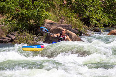 Water Rapids Canoe Race. AJ Birkett  in the fast river rapids with his canoe at mid day the Non Stop Dusi canoe marathon. Photo image captures the athlete Stock Photography