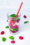 WATER with raspberries and mint Stock Photos