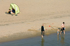 Water recreation on the beach of the river Waal. Netherlands, province Gelderland, aerial view of men and woman who play on the beach of the River Waal in the Stock Images