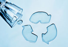 Water recycling. Glass of water spilled into shape of  recycle symbol Stock Photography
