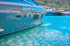 Water reflected on a yacht hull in Porto Cervo harbor Stock Photo