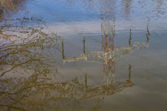 Water reflecting an electricity tower Royalty Free Stock Images