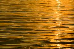 Water reflecting orange yellow. Royalty Free Stock Image