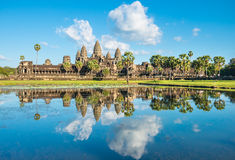 Water reflection of Angkor Wat temple in Cambodia. Famous khmer Angkor Wat temple in Cambodia with water reflection Stock Photo