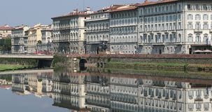 Water Reflection Of Buildings In Arno River In Florence. Florence, Italy - August 31, 2019: Water Reflection Of Old Buildings In Arno River In Florence, Italy stock video