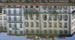 Water Reflection Of Colorful Buildings In The Arno River In Florence. Florence, Italy - August 31, 2019: Water Reflection Of Colorful Old Buildings In The Arno stock video footage