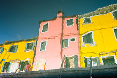 Water reflection of colorful houses in Burano, Venice, Italy Stock Image