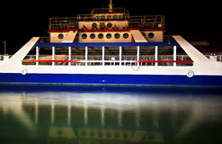 Water reflection of a ferry boat at night Royalty Free Stock Image