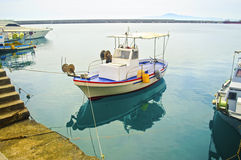 Water reflection of a fishing boat Greece Stock Photography
