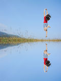 Water Reflection Happy Woman Jumping with blue sky Royalty Free Stock Photos