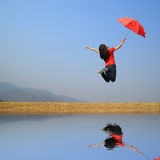 Water Reflection Red umbrella woman Royalty Free Stock Image