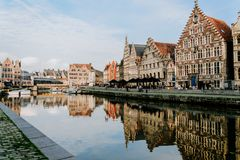 Water reflection on the river bank in Ghent. With a panoramic view royalty free stock photo