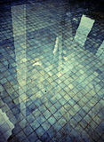Water reflection shadow on the tiled floor Stock Photo