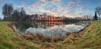 Water reflection at sunrise in lake, panorama Royalty Free Stock Photo