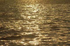 Water reflection at sunset royalty free stock photography