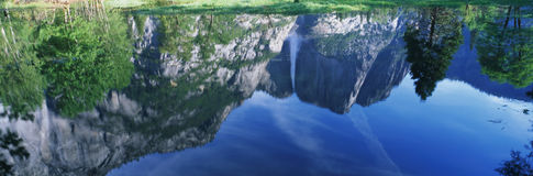 This is a water reflection of Upper Yosemite Falls in the spring. Stock Images