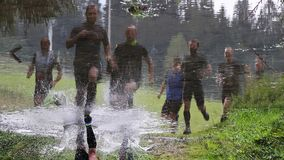 Reflections of athletes at Spartan obstacle running race Stock Photos