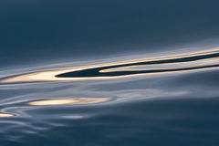 Water reflections in the blue sea Stock Photos