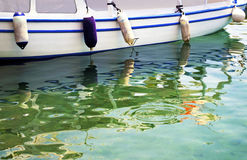 Water reflections of a boat Stock Photos