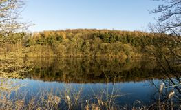 Water reflections on a calm day at Fewston Reservoir, North Yorkshire royalty free stock images