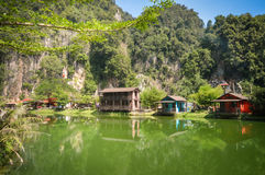 Water reflections in the countryside of Ipoh city, Perak, Malaysia. South East Asia. Water reflections of wooden houses with limestones on the background in the stock photos