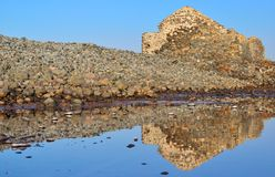 Water reflections of old construction in salt lagoon Stock Photo