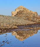 Water reflections of old stone construction in  lagoon Royalty Free Stock Image