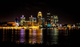 Louisville kentucky skyline at night shot from the Indiana border. Water reflections shine from the city lights of Louisville Kentucky stock photo