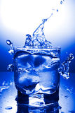 Water refreshing. Glass  and water refreshing on a blue background Royalty Free Stock Images