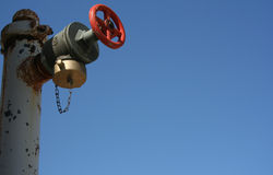 Water Release Valve. A water release valve on a clear blue sky with plenty of copy space Royalty Free Stock Photography