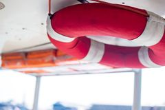 Water rescue equipment or water ring rescue and Lifebuoy. On the boat with red and white color use for rescue accident Stock Photos