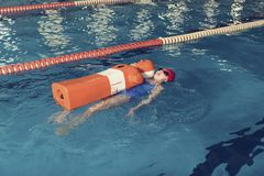 Water Rescue Training One Girl in a School Pool Corridor Royalty Free Stock Photography