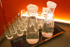 Water Reserves. Two glass bottles and glass beaker. Royalty Free Stock Photography