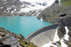 Water reservoir. Glacier, water reservoir, and dam Royalty Free Stock Photo