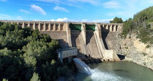 Water reservoir and hydroelectric power generating station general view. Water reservoir and hydroelectric power generating station in Spain. Horizontal royalty free stock image