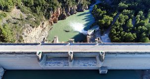 Water reservoir and hydroelectric power generating station top v. Water reservoir and hydroelectric power generating station in Spain. Horizontal composition stock photography