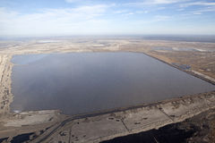 A water reservoir in the oil sands in Alberta, Canada Stock Photo