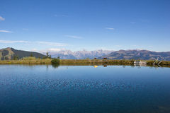 Water Reservoir On Schmittenhöhe In Zell Am See With View To Steinernes Meer & Hochkönig. Taken on September 29th, 2015 - Wonderful and sunny days in fall with Royalty Free Stock Photo