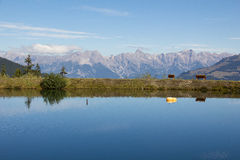 Water Reservoir On Schmittenhöhe In Zell Am See With View To Steinernes Meer & Hochkönig. Taken on September 29th, 2015 - Wonderful and sunny days in fall with Stock Photo