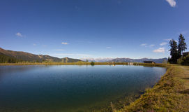 Water Reservoir On Schmittenhöhe In Zell Am See With View To Steinernes Meer & Hochkönig. Taken on September 29th, 2015 - Wonderful and sunny days in fall with Royalty Free Stock Image