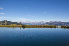 Water Reservoir On Schmittenhöhe In Zell Am See With View To Steinernes Meer & Hochkönig Royalty Free Stock Image