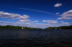 Water Reservoir on a Summer Day with Sailboats taking part in a Regatta Royalty Free Stock Photography